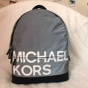 Grey and Black Michael Kors reflective Back pack.